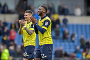 Oxford United Defender, Cheyenne Dunkley (33) and Oxford United Forward, Marvin Johnson (28) celebrate the win at full time during the EFL Sky Bet League 1 match between Oxford United and Scunthorpe United at the Kassam Stadium, Oxford, England on 18 March 2017. Photo by Adam Rivers.