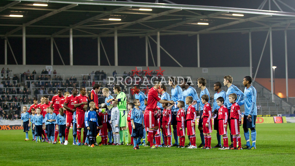ST HELENS, ENGLAND - Wednesday, March 14, 2012: Liverpool's captain Conor Coady lead his team before the NextGen Series Semi-Final match against AFC Ajax at Langtree Park. (Pic by Vegard Grott/Propaganda)