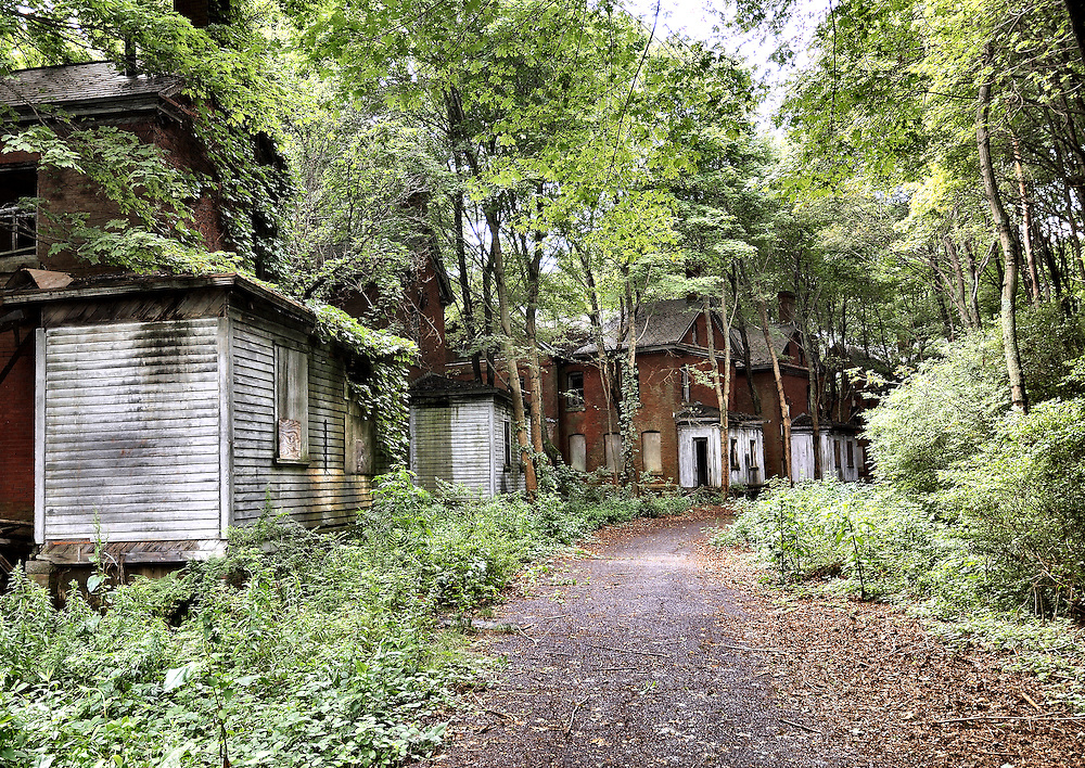 Abandoned officer buildings from the Fort Andrews Army Base era line officers row along Peddocks Island in Boston Harbor.