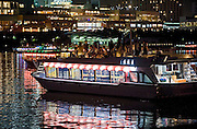 """Customers enjoy the above-deck views of the Odaiba district from one of Harumiya Co.'s """"yakata-bune"""" pleasure boats in Tokyo Bay, Japan on 31 August  2010. .Photographer: Robert Gilhooly"""