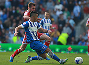 Brighton central midfielder Beram Kayal lays the ball off under pressure from Cardiff City midfielder Joe Ralls during the Sky Bet Championship match between Brighton and Hove Albion and Cardiff City at the American Express Community Stadium, Brighton and Hove, England on 3 October 2015. Photo by Bennett Dean.