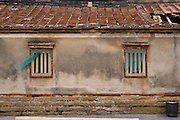 Old Fujian style housing on Kinmen, Republic of China ROC (Taiwan). Kinmen (Jinmen) formely known as Quemoy. The island lies less than 2km off the coast of China, and in 1949 was turned into a front-line of defense for Taiwan by Chiang Kai-shek and the Chinese nationalist Kuomintang (KMT) in the ongoing war with the communist PRC. The island existed under martial law until 1993. Today, Kinmen is a popular tourist destination and home to a lot of traditional Fujian-style architecture