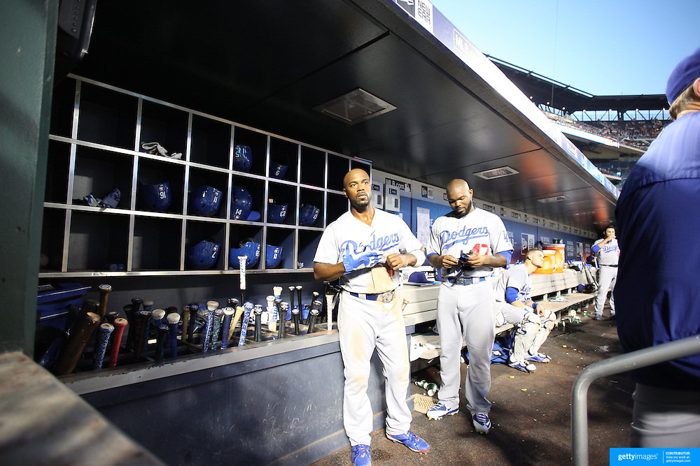 Howie Kendrick, (right), and Jimmy Rollins, Los Angeles Dodgers, in the dugout preparing to bat during the New York Mets Vs Los Angeles Dodgers MLB regular season baseball game at Citi Field, Queens, New York. USA. 25th July 2015. Photo Tim Clayton