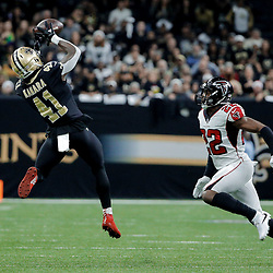 Dec 24, 2017; New Orleans, LA, USA; New Orleans Saints running back Alvin Kamara (41) catches a pass over Atlanta Falcons strong safety Keanu Neal (22) during the first quarter at the Mercedes-Benz Superdome. Mandatory Credit: Derick E. Hingle-USA TODAY Sports