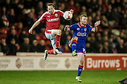Aidan White (Barnsley) jumps to control the ball with the Oldham player beaten during the Sky Bet League 1 match between Barnsley and Oldham Athletic at Oakwell, Barnsley, England on 12 April 2016. Photo by Mark P Doherty.