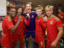 NEWPORT, WALES - Thursday, November 5, 2015: Wales' Rabbi Matonda, captain Ethan Ampadu, goalkeeper Adam Przybeck, Ryan Stirk and Keiron Proctor celebrate in the dressing room after retaining the Victory Shield with a 3-1 win over Northern Ireland during the Under-16's Victory Shield International match at Dragon Park. (Pic by David Rawcliffe/Propaganda)
