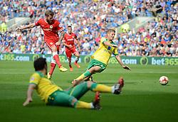 Cardiff City's Aron Gunnarsson scores. - Photo mandatory by-line: Alex James/JMP - Mobile: 07966 386802 30/08/2014 - SPORT - FOOTBALL - Cardiff - Cardiff City stadium - Cardiff City  v Norwich City - Barclays Premier League