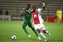 Cape Town-180424Ajax Cape Town striker Yannick Zakri tackled by Baroka defender Mothupa Mathari In a PSL game at   at Athlone stadium.photographer:Phando Jikelo/African News Agency/ANA