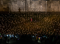 © Licensed to London News Pictures. 08/11/2018. LONDON, UK. 'Beyond the Deepening Shadow: The Tower Remembers'  <br /> An installation at The Tower of London. Which consists of thousands of individual flames illuminate the moat of The Tower of London to mark 100 year since the first World War ended, The installation entitled 'Beyond the Deepening Shadow: The Tower Remembers', is a public act of remembrance for the lives of the fallen, honouring their sacrifice will run for eight nights, leading up to and including the Centenary Armistice Day 2018. <br />   Photo credit: Andrew Baker/LNP