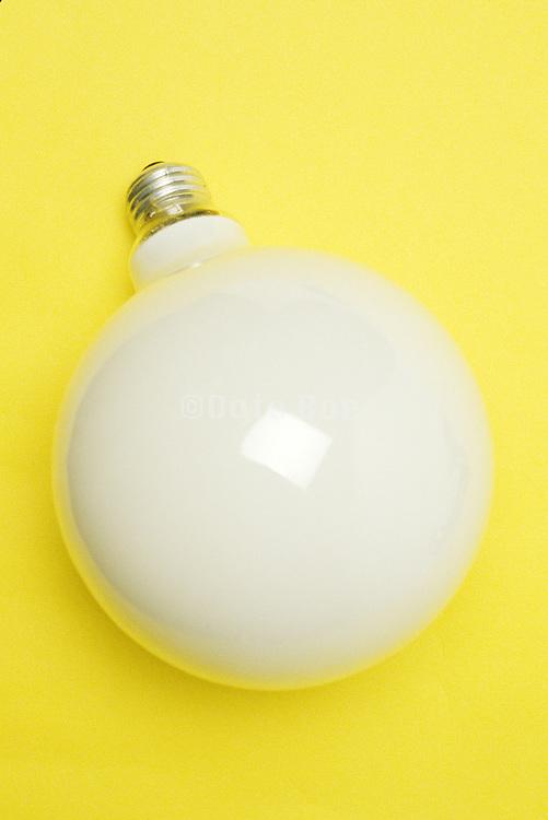 vanity light bulb on yellow background