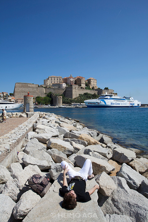 The modern speed ferry linking Calvi to Nice is moored below the Citadel.