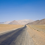 Barren and desolate Pamir Highway crossing the high-altitude plateau