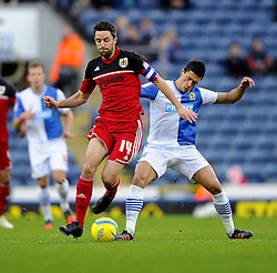 Bristol City's Cole Skuse battles for the ball with Blackburn Rovers' Jason Lowe - Photo mandatory by-line: Joe Meredith/JMP  - Tel: Mobile:07966 386802 05/01/2013 - Blackburn Rovers v Bristol City - SPORT - FOOTBALL - FA Cup -  BLACKBURN - EWOOD PARK -