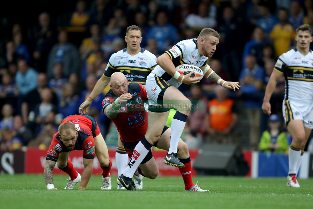 Leeds Rhino's Brad Singleton escapes a challenges from featherstones John Davies during the Ladbrokes Challenge Cup, quarter-final match at Headingley Carnegie Stadium, Leeds.