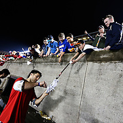 Paul Rabil #99 of the Boston Cannons signs an autograph following the game at Harvard Stadium on May 10, 2014 in Boston, Massachusetts. (Photo by Elan Kawesch)