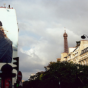 An Armani fashion advert in the streets of Paris with the Eiffel Tower in the distance.  Paris, France, Photo Tim Clayton