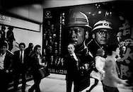 Advert for a blue collar film in a white collar city, Shibuya Station, Tokyo, Japan.  The blue collar has been hit particularly hard by the financial crisis, especially contract workers but the white collar is far from unscathed.