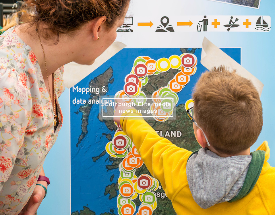 Dynamic Earth, Edinburgh, Scotland, United Kingdom, 9 April 2019. Edinburgh Science Festival:  Jamie Carter, age 8 years, has fun learning about plastic pollution in the sea at Scrapbook: Fight Ocean Plastics from the Skies with Sophie Green at Dynamic Earth at the Edinburgh Science Festival. <br /> <br /> Sally Anderson | EdinburghElitemedia.co.uk
