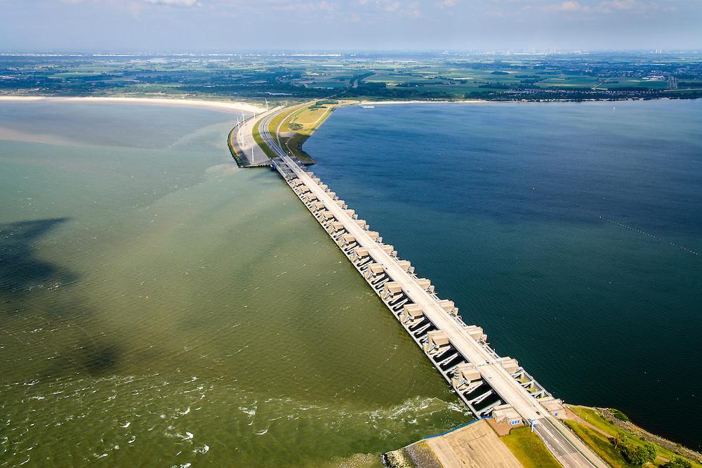 Nederland, Zuid-Holland, Gemeente Dirksland, 10-06-2015;  Haringvliet met Haringvlietsluizen en Haringvlietdam. Zesde werk van de Deltawerken, verbindt met de N57 Voorne-Putten en Goeree-Overflakkee. In het kader van modern natuurbeheer ('getemd getij') gaan de sluizen tegenwoordig bij eb en vloed beperkt open om de getijden hun enigszins terug te laten komen in het estuarium.<br /> Dam and sluices between islands Voorne-Putten en Goeree-Overflakkee. The sluices are for draining water coming from the rivers Rhine and Maas (Meuse) from the natural bassin to the North sea. Modern ecological insight has led to opening the sluices semi-permanently, resulting in the estuary function of the Haringvliet patially being restored.<br /> luchtfoto (toeslag op standard tarieven);<br /> aerial photo (additional fee required);<br /> copyright foto/photo Siebe Swart