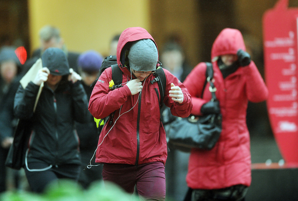 City commuters battle wind and rain as a southerly storm hits the capital, Wellington, New Zealand, Wednesday, September 11, 2013. Credit:SNPA / Ross Setford
