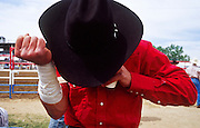 18 MAY 2002 -- MILES CITY, MONTANA, USA: A cowboy tapes his arm before riding at the Miles City Bucking Horse Sale in Miles City, MT. The sale is a virtual marathon of bucking, many of the cowboys ride 4 or five horses per day.  The MCBHS is the largest auction of rodeo roughstock in the US. More than 250 horses and 30 bulls are bucked and sold during the sale, which is also a huge tourist draw and the largest community gathering in eastern Montana. PHOTO BY JACK KURTZ  LIFESTYLE  CULTURE  SPORTS  TOURISM