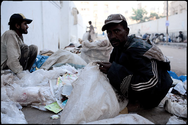 """Heroin addicts select items from the garbage to resale. Karachi, Pakistan, on friday, December 05 2008.....""""Pakistan is one of the countries hardest hits by the narcotics abuse into the world, during the last years it is facing a dramatic crisis as it regards the heroin consumption. The Unodc (United Nations Office on Drugs and Crime) has reported a conspicuous decline in heroin production in Southeast Asia, while damage to a big expansion in Southwest Asia. Pakistan falls under the Golden Crescent, which is one of the two major illicit opium producing centres in Asia, situated in the mountain area at the borderline between Iran, Afghanistan and Pakistan itself. .During the last 20 years drug trafficking is flourishing in the Country. It is the key transit point for Afghan drugs, including heroin, opium, morphine, and hashish, bound for Western countries, the Arab states of the Persian Gulf and Africa..Hashish and heroin seem to be the preferred drugs prevalence among males in the age bracket of 15-45 years, women comprise only 3%. More then 5% of whole country's population (constituted by around 170 milion individuals),  are regular heroin users, this abuse is conspicuous as more of an urban phenomenon. The substance is usually smoked or the smoke is inhaled, while small number of injection cases have begun to emerge in some few areas..Statistics say, drug addicts have six years of education. Heroin has been identified as the drug predominantly responsible for creating unrest in the society."""""""