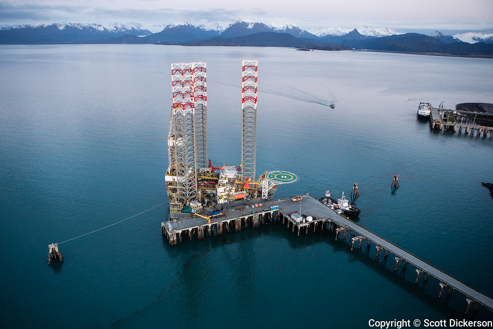 Aerial view of Buccaneer Energy's jack-up oil and gas drilling rig docked on the Homer deep water dock. Kenai Peninsula, Cook Inlet, Kachemak Bay, Homer, Alaska, Homer Spit, Homer Harbor.