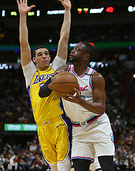 March 1, 2018 - Miami, FL, USA - The Miami Heat's Dwyane Wade, right, attempts a shot against the Los Angeles Lakers' Lonzo Ball during the second quarter at the AmericanAirlines Arena in Miami on Thursday, March 1, 2018. The Lakers won, 131-113. (Credit Image: © David Santiago/TNS via ZUMA Wire)