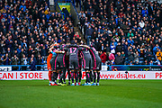 Leeds United players huddle during the EFL Sky Bet Championship match between Huddersfield Town and Leeds United at the John Smiths Stadium, Huddersfield, England on 7 December 2019.