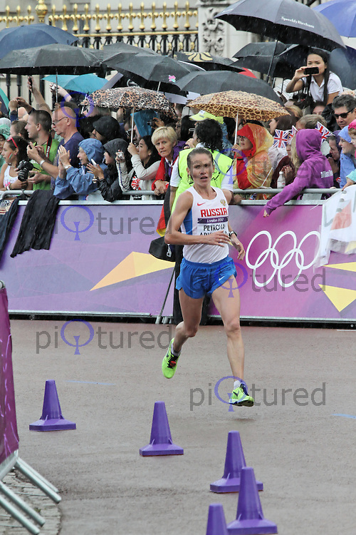 LONDON - AUGUST 05: Petrova Tatyana Arkhipova wins Bronze for Russia in the Women's Olympic Marathon, Buckingham Palace, London, UK. August 05, 2012. (Photo by Richard Goldschmidt)
