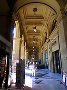 Shops and Banks along the Piazza della Repubblica, Florence, Italy. The ancient centre of the city which was restored in the 19th century, when Florence was briefly made the capital city of a reunited Italy. The arch was completed in 1895, and bears a plaque with the date and statement of the restoration.