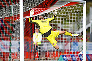 Crawley Town goalkeeper Glenn Morris tips the ball over the bar from a free kick in the second half during the EFL Sky Bet League 2 match between Crawley Town and Morecambe at the Broadfield Stadium, Crawley, England on 15 September 2018.