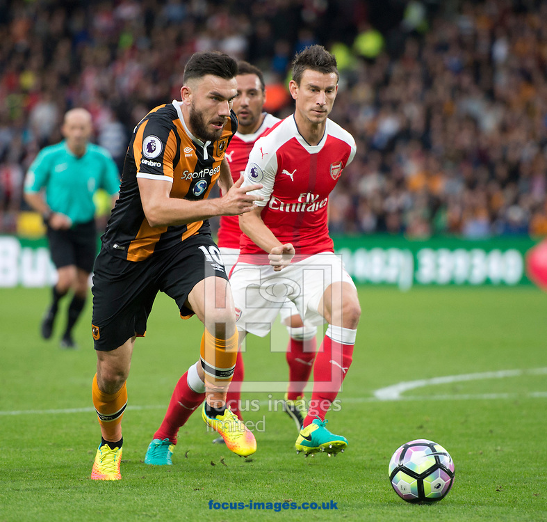 Robert Snodgrass of Hull City (left) gets past Laurent Koscielny of Arsenal during the Premier League match at the KCOM Stadium, Hull<br /> Picture by Russell Hart/Focus Images Ltd 07791 688 420<br /> 17/09/2016
