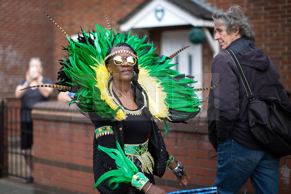 © Licensed to London News Pictures . 13/08/2016 . Manchester , UK . The annual Caribbean Carnival Parade through Hulme and Moss Side in South Manchester . Photo credit : Joel Goodman/LNP