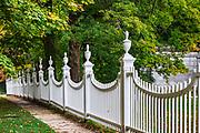 Charming New England picket fence with autumn foliage, Bennington, Vermont, USA.