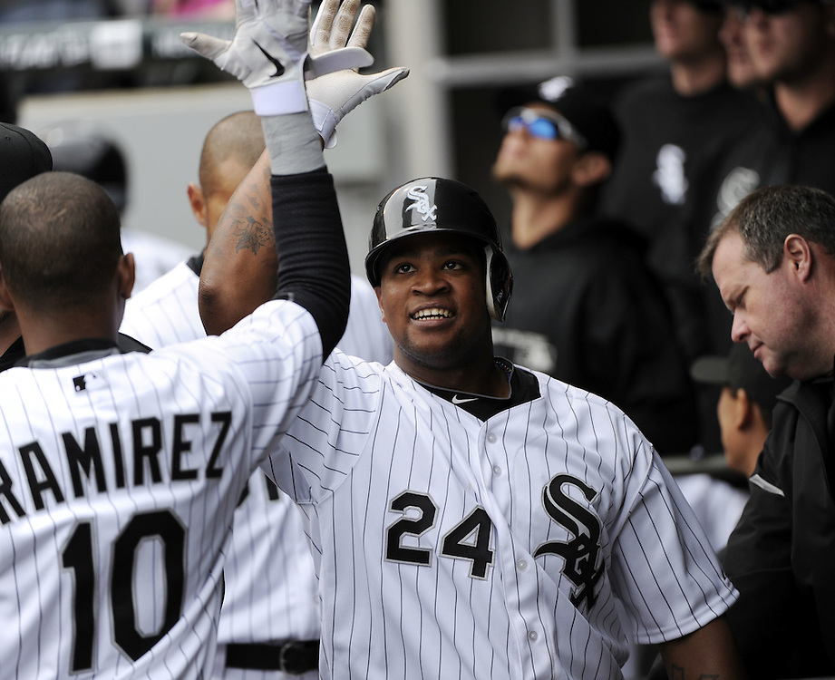 CHICAGO - APRIL 13:  Dayan Viciedo #24 of the Chicago White Sox celebrates with teammates after hitting a home run in the fifth inning against the Detroit Tigers on Opening Day, April 13, 2011 at U.S. Cellular Field in Chicago, Illinois.  The White Sox defeated the Tigers 5-2.  (Photo by Ron Vesely/Chicago White Sox)  Subject:  Dayan Viciedo