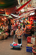 Graham Street Market, Hong Kong - The market is 160 years old and is Hong Kong's oldest continuously-operating street market with narrow stalls on either sides.  The market sells seafood, vegetables, meats and other dry goods. Graham Street was featured in a scene from the film Rush Hour 2.