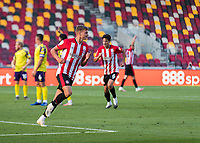 Football - 2020 / 2021 Sky Bet (EFL) Championship - Brentford vs. Huddersfield Town <br /> <br /> Marcus Forss (Brentford  FC) turns away after scoring from close range to give his team a two goal advantage at the Brentford Community Stadium<br /> <br /> COLORSPORT/DANIEL BEARHAM