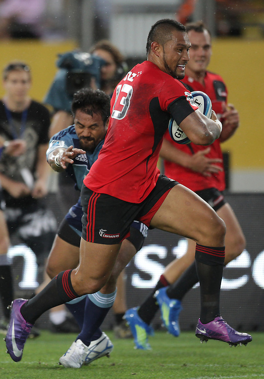 Crusaders' Robbie Fruean beats Blues' Isaia Toeava to run home a try in a Super Rugby match, Eden Park, Auckland, New Zealand, Friday, February 24, 2012.  Credit:SNPA / David Rowland