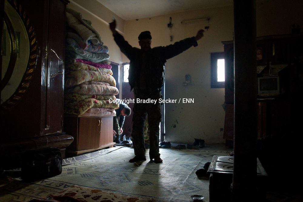 A Syrian Free Army soldier dances in celebration as he receives news that government forces have retreated from a neighbouring village. Al Janoudiyah, Syria