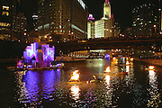 Great Chicago Fire Festival on Saturday, October 4, 2014. Crowd watches from Wasbash Avenue Bridge as kayaks with fire buoys move along the Chicago river