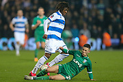 Queens Park Rangers midfielder Eberechi Eze (10) challenged by Sheffield Wednesday midfielder Alex Hunt (29) during The FA Cup match between Queens Park Rangers and Sheffield Wednesday at the Kiyan Prince Foundation Stadium, London, England on 24 January 2020.