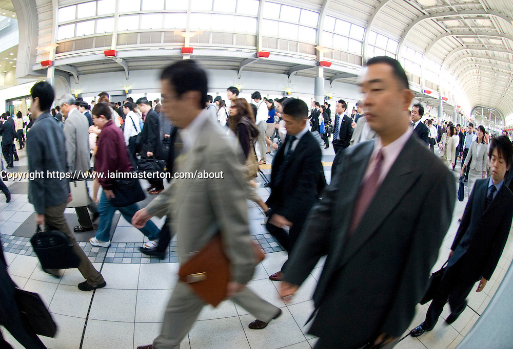 Crowds of commuters walking to work in central Tokyo Japan