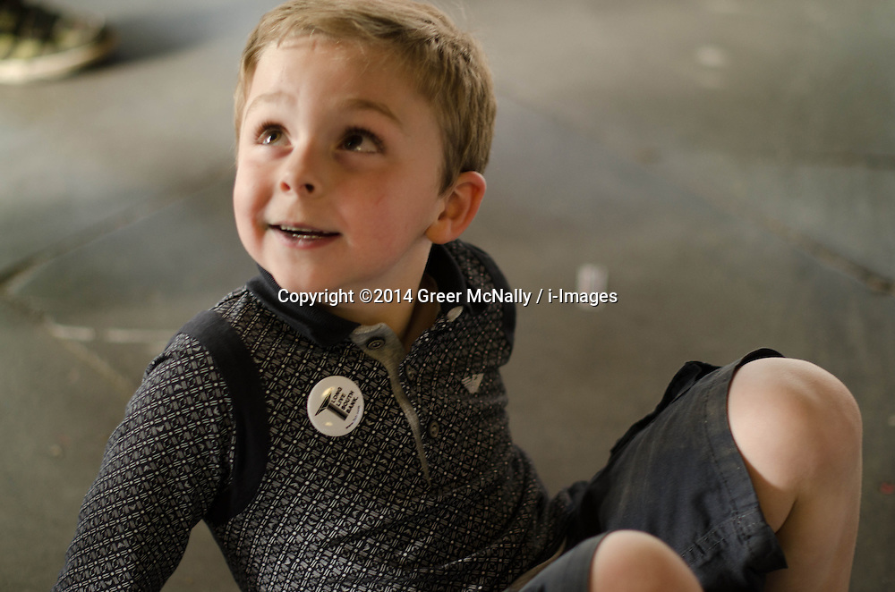 A young supporter of the Long Live Southbank campaign looks away from the action for a moment to check his mother is still there