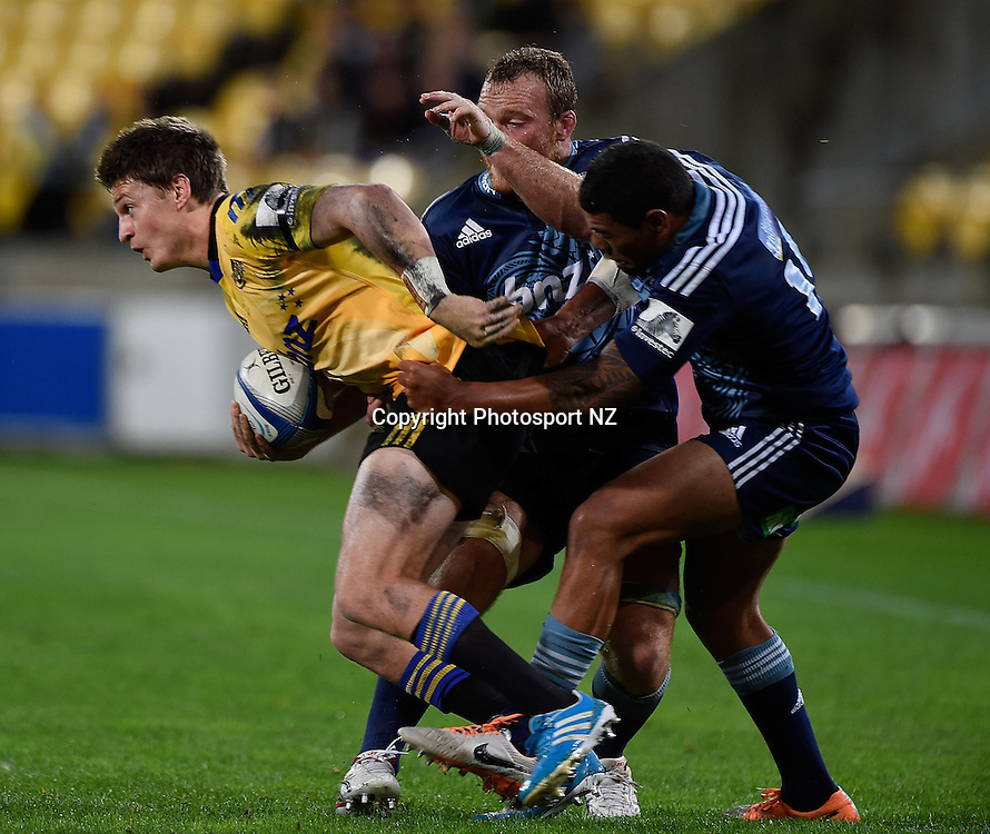 Beauden Barrett (L) of the Hurricanes is tackled by Charles Piutau (R and Luke Braid captain of the Blues during the Super Rugby - Hurricanes v Blues match at the Westpac Stadium in Wellington on Friday the 18th of April 2014.  Photo by Marty Melville/Photosport.co.nz