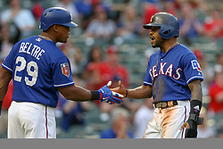March 26, 2018 - Arlington, TX, U.S. - ARLINGTON, TX - MARCH 26: Texas Rangers third baseman Adrian Beltre (29) shakes hands with center fielder Delino DeShields (3) during the exhibition game between the Cincinnati Reds and Texas Rangers on March 26, 2018 at Globe Life Park in Arlington, TX. (Photo by Andrew Dieb/Icon Sportswire) (Credit Image: © Andrew Dieb/Icon SMI via ZUMA Press)