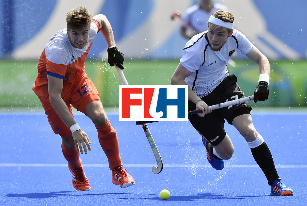 Netherlands' Sander de Wijin (L) vies with Germany's Christopher Ruhr during the men's Bronze medal field hockey Netherlands vs Germany match of the Rio 2016 Olympics Games at the Olympic Hockey Centre in Rio de Janeiro on August 18, 2016. / AFP / PHILIPPE LOPEZ        (Photo credit should read PHILIPPE LOPEZ/AFP/Getty Images)