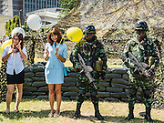 09 JANUARY 2016 - BANGKOK, THAILAND: Women pose with Thai army special forces personnel during Children's Day festivities at the Royal  Thai Army's Palace Guard, 2nd Division Cavalry Base in Bangkok. National Children's Day falls on the second Saturday of the year. Thai government agencies sponsor child friendly events and the military usually opens army bases to children, who come to play on tanks and artillery pieces.         PHOTO BY JACK KURTZ