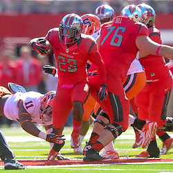 Oct 13, 2012: Rutgers Scarlet Knights running back Jawan Jamison (23) steps through Syracuse Orange linebacker Marquis Spruill's (11) arm tackle during NCAA Big East college football action between the Rutgers Scarlet Knights and Syracuse Orange at High Point Solutions Stadium in Piscataway, N.J.