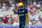 Wicket - Chris Wood of Hampshire looks dejected as he walks back to the pavilion after being dismissed by Jamie Overton of Somerset during the Royal London 1 Day Cup Final match between Somerset County Cricket Club and Hampshire County Cricket Club at Lord's Cricket Ground, St John's Wood, United Kingdom on 25 May 2019.